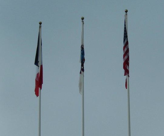 Normandy Sightseeing Tours: Flags at Omaha, Normandy