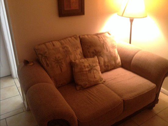 Palm Beach Oceanfront Inn: sofa with hole in it