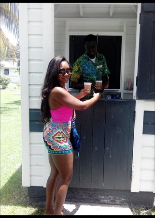 Coyaba Beach Resort: having Carib at the beach bar