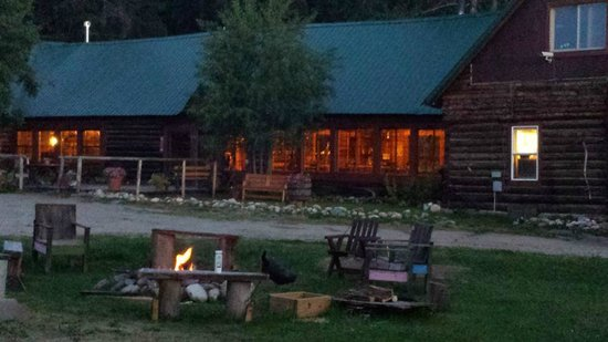 Medicine Bow Lodge: The Main Lodge at Twilight with a S'more Fire Going