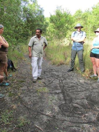 Jacamar Naturalist Tours: Tour guide discussing volcano history