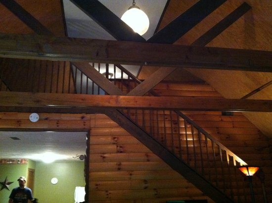 Blue Rose Cabins: View from living room area into loft (beam and light have layer of dust)