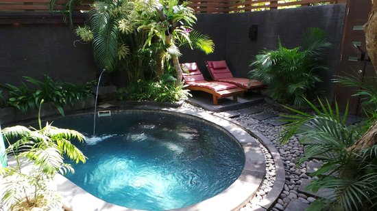Bali Dream Suite Villa: Part of the pool and the pool chairs