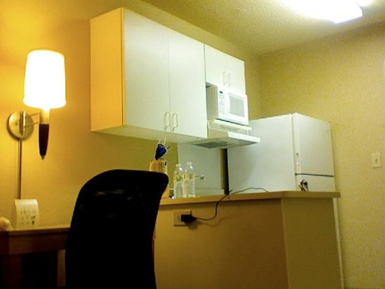 Extended Stay America - Raleigh - Cary - Regency Parkway North: 1 of 2 Work/Eating Areas with the Kitchen behind it