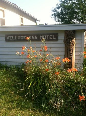 Village Inn Motel: The back sign in the garden near the nature trail.