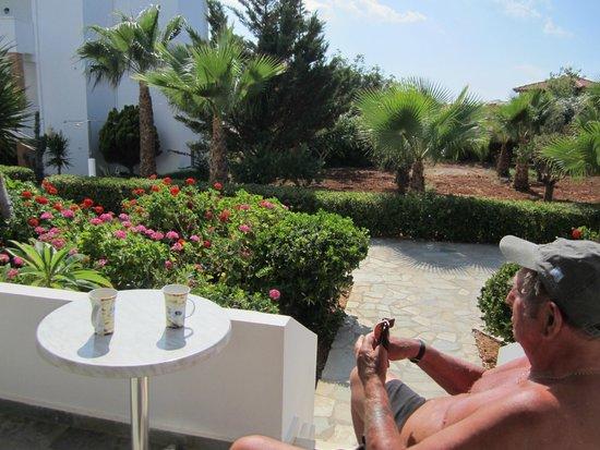 Alexander Beach Hotel & Village: Sitting on the porch having a drink