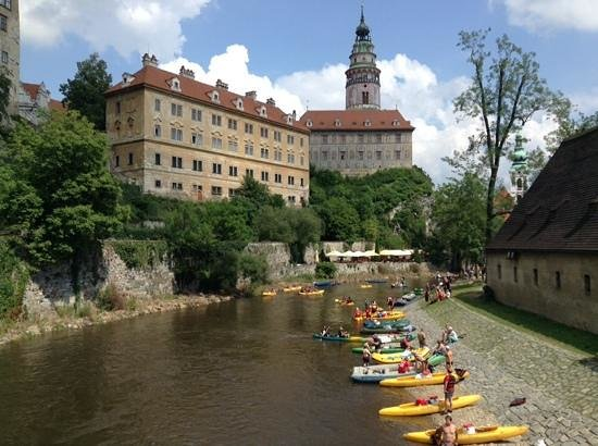 Historic Center of Cesky Krumlov: local families enjoying the river