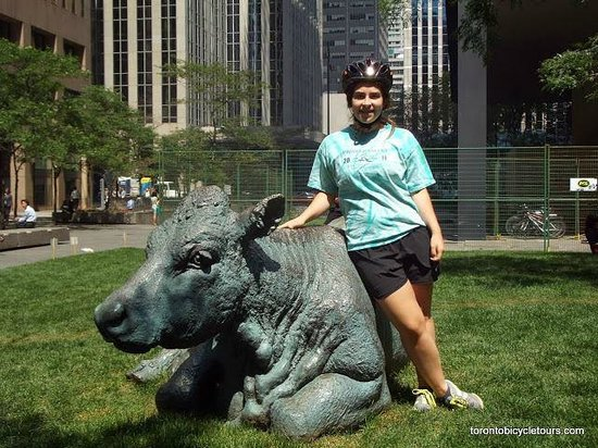 Toronto Bicycle Tours : my daughter at the very cool cow statues in financial district