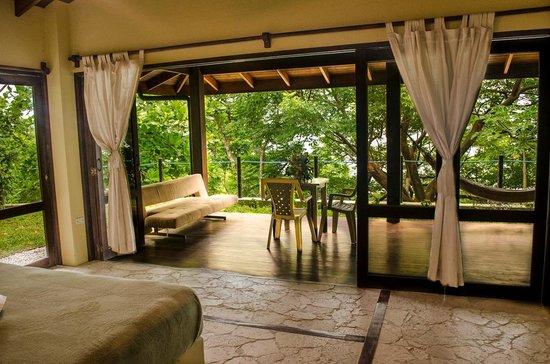 Gumbo Limbo Villas: View from bed to the deck, Villa Indio (2BR villa)