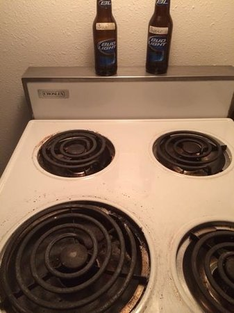 The Brooks Hotel : stove top with bud light salt and pepper shakers