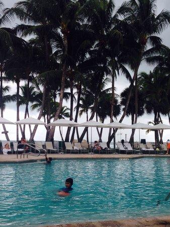 Casa Marina, A Waldorf Astoria Resort: My son having fun in the beautiful pool...