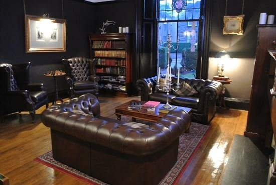 23 Mayfield: Relaxing sitting area with books and a well stocked scotch bar.