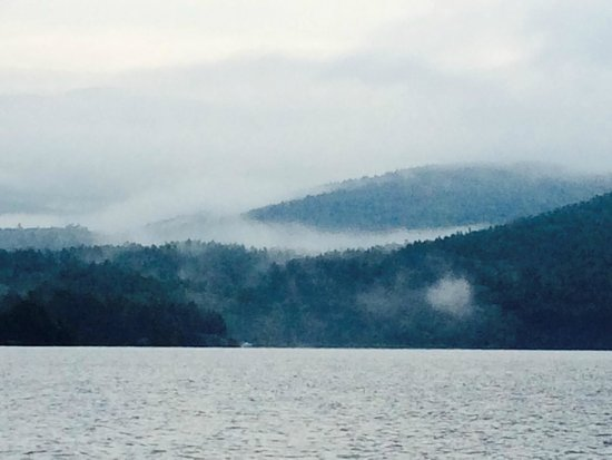 Adirondack Mountains at dawn from boat on Lake George