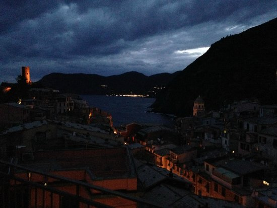 Elisabetta Carro: the harbor with a storm coming in in the evening from the rooftop patio