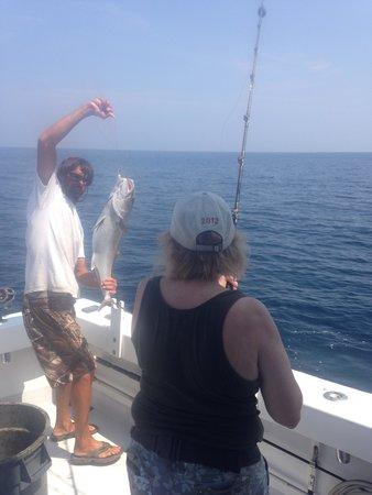 Huntress Charter Fishing: Groovey bringing an Amberjack aboard