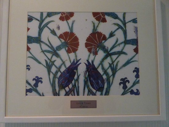Hotel Amira Istanbul: Hand painted Iznik tile framed, in the hall outside room.  Gorgeous