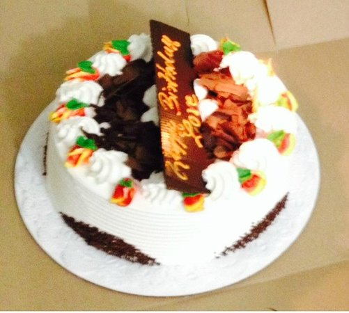 Graf's Pastry : Rum Cake - 3 layer chocolate cake, 2 layer yellow cake, whipping and also one layer of custard c