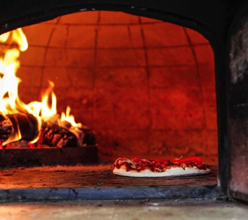 BASE Woodfired Pizza: pizza in oven