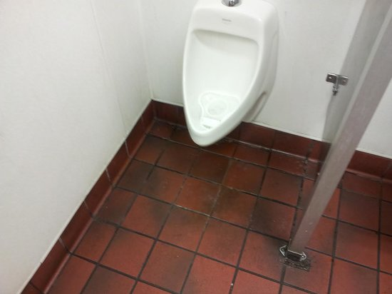 Carl's Jr.: Urinal smells.  Not been cleaned for a while ???