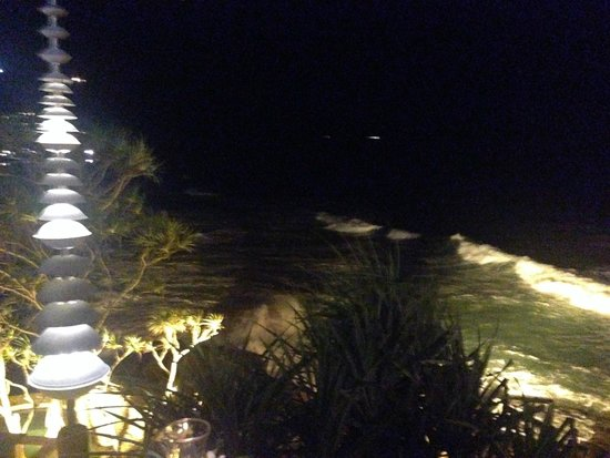 Mom Tri's Kitchen at Villa Royale: A night time view over Kata Noi surf from Mom Tri's Kitchen