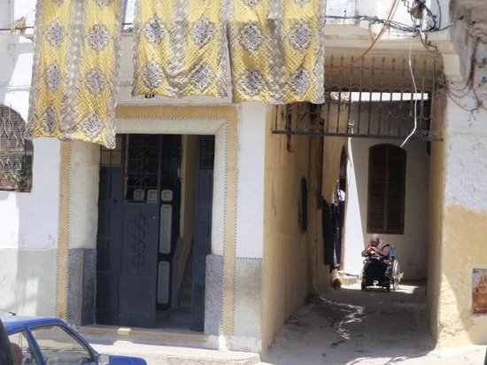 Medina of Tangier : Laundry Day and I love the lady watching the world go by with her cats