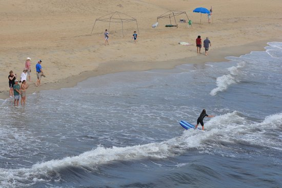 one of the students catching a great wave picture of outer banks rh tripadvisor com
