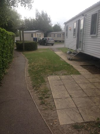 Burnham on Sea Holiday Park - Haven: Outside 10 Elm Grove.  Not pleasant sitting by a busy path
