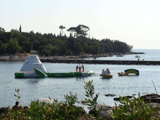 Island Hotel Istra: Inflatable slides in the sea