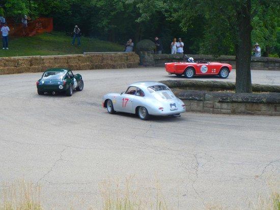 Schenley Park: Triumph TR4, Triumph Spitfire, and Porsche at hairpin.
