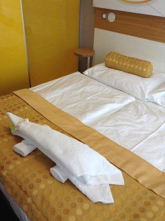 Hotel Golf: Originálně nachystaná osuška ve tvaru krokodýla