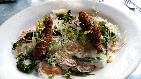 Jamie's Italian: 2 tiny crabs and onion heavy 'salad'. So not worth almost £16...