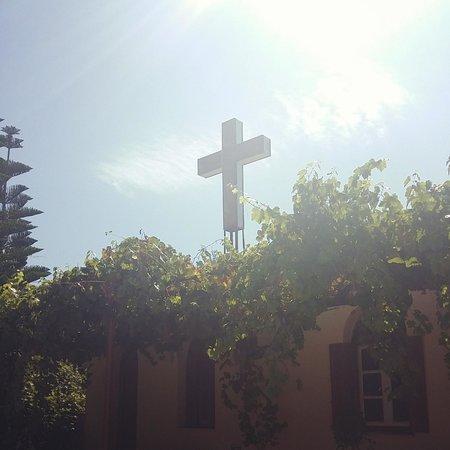 Kipoureon Monastery : Illuminated Crucifix on roof overlooking sea