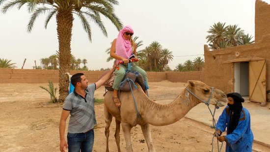 Discover Morocco Tours: Rachid helping me onto my camel!