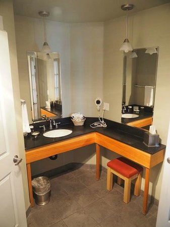 Cannery Pier Hotel : The bathroom counter with a seat so you can sit and put on your make-up