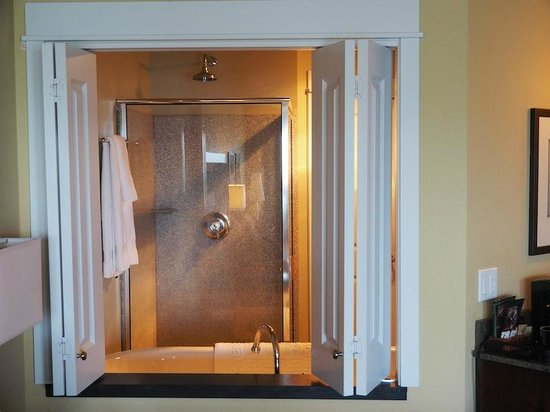 Cannery Pier Hotel : Shower, seen from the bedroom. The louvres pull shut if you want privacy