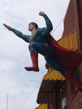 Superman Statue: Superman takes flight from a nearby building