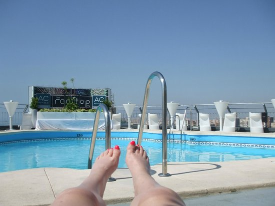 AC Hotel Malaga Palacio: lounging by the rooftop pool