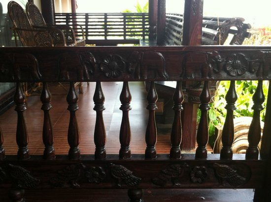 Palm Tree Heritage: Kerala-style terrace: sculpted wood