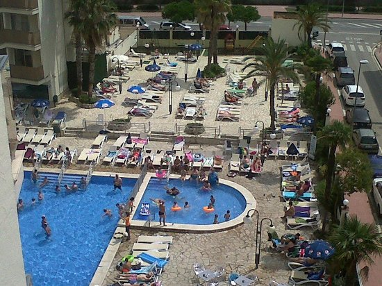 H·TOP Royal Beach: Main pool, sun beds and children's play area with table tennis table