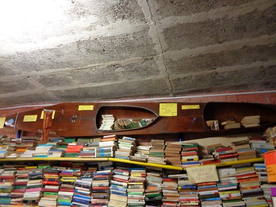 Libreria Acqua Alta: a boat on a wall