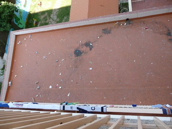 H·TOP Olympic: Another one from balcony...Terrace covered with rubbish of all kind and spit