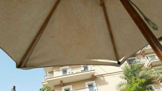 The Ritz-Carlton, Dubai: Ripped and broken pool umbrellas are the norm sadly