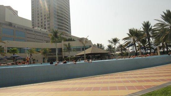 Beach Rotana: Pool and the bar inside
