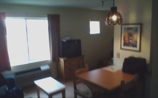"The Santa Fe Suites: TV, not watchable. ""couch"" not visible."