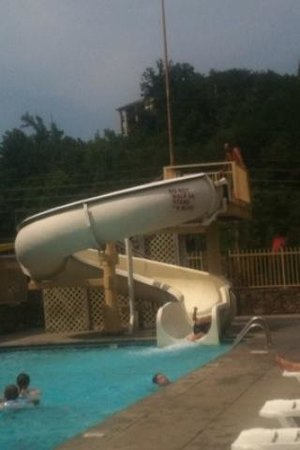 My son coming down the slide, my husband up top.