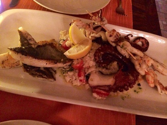 Dalmatino Dubrovnik : Seafood platter for 2 - 3 fish, 2 skewers and octopus on a bed of seafood risotto. Very tasty!!