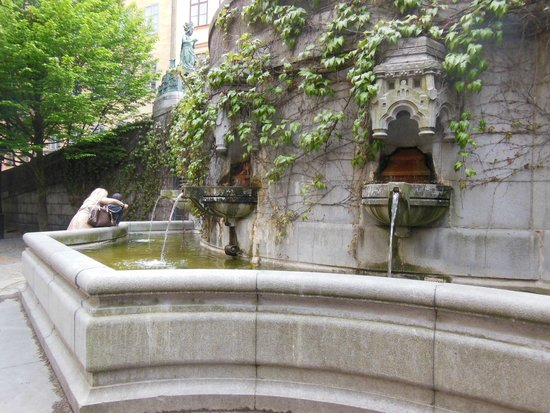 A small fountain across the square from the entrance to Fem Sma Hus