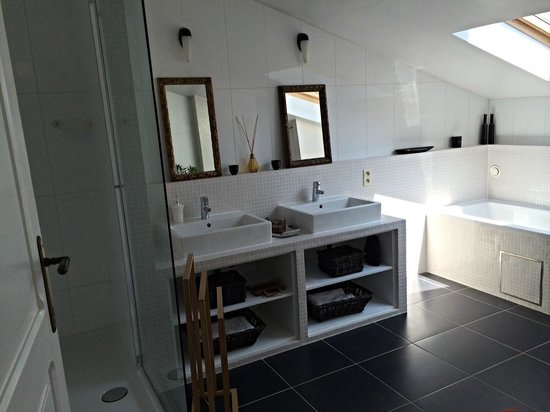 House Ninety: The cute bathroom, with sky light for bath and a nice shower