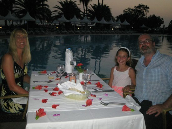 Turquoise Resort Hotel & Spa: Dining in the Steak House restaurant by the pool, table decorated for my husband's birthday