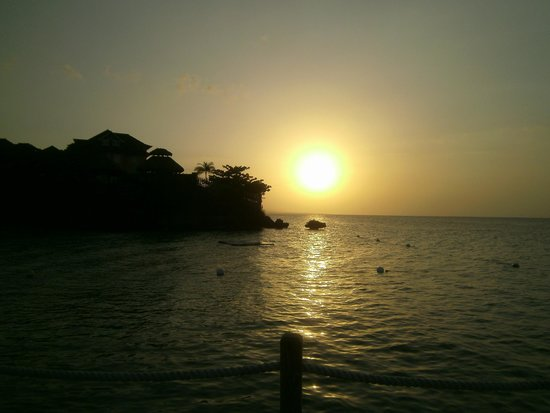 Sandals Ochi Beach Resort: And when you have sunsets like these you can see why!